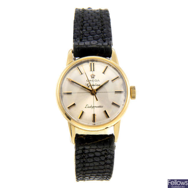 OMEGA - a lady's yellow metal Ladymatic wrist watch.