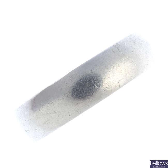 A platinum band ring.