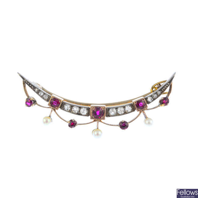 An early 20th century silver and gold gem-set and diamond bar brooch.