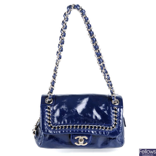 CHANEL - a small Luxe Ligne Flap handbag.