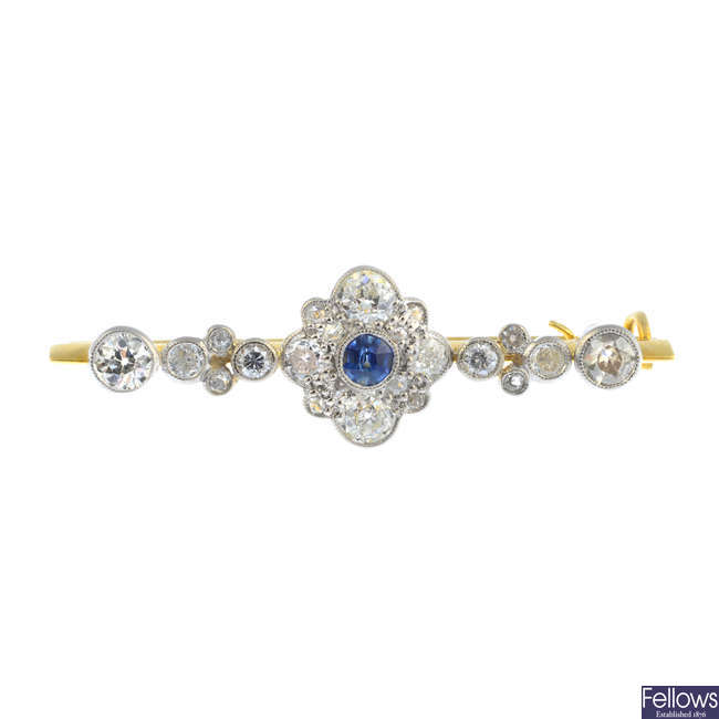 An early 20th century gold sapphire and diamond bar brooch.