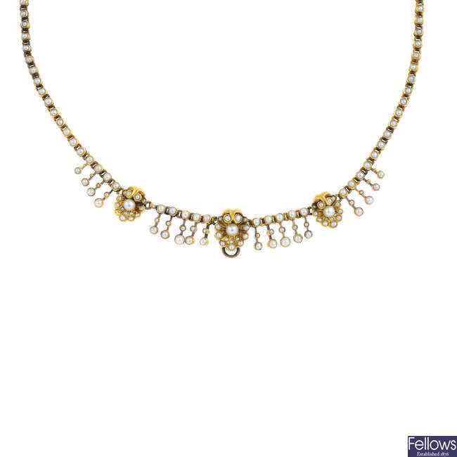 An early 20th century gold seed and split pearl necklace.