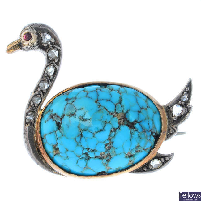 An early 20th century silver and gold, turquoise, diamond and ruby swan brooch.