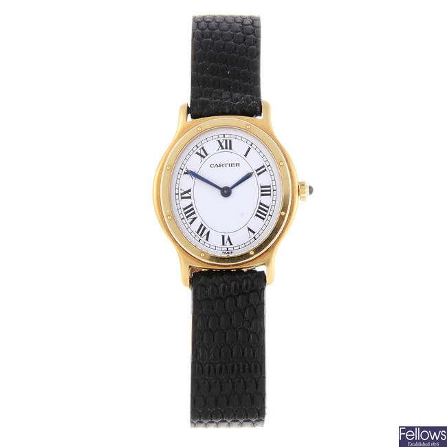 CARTIER - an 18ct yellow gold wrist watch.