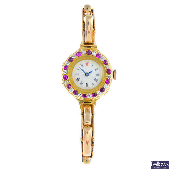 A lady's early 20th century 18ct gold and enamel diamond and ruby wrist watch.