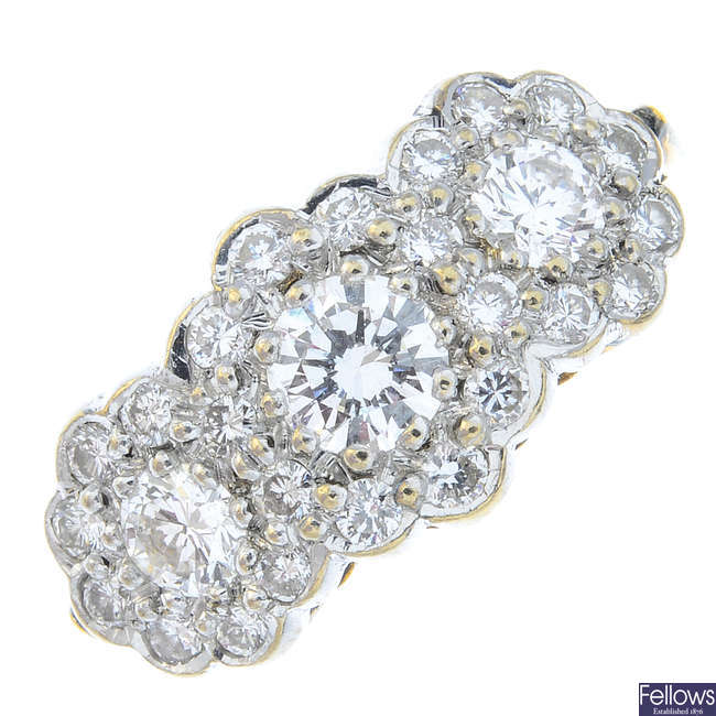 An 18ct gold diamond triple cluster ring.