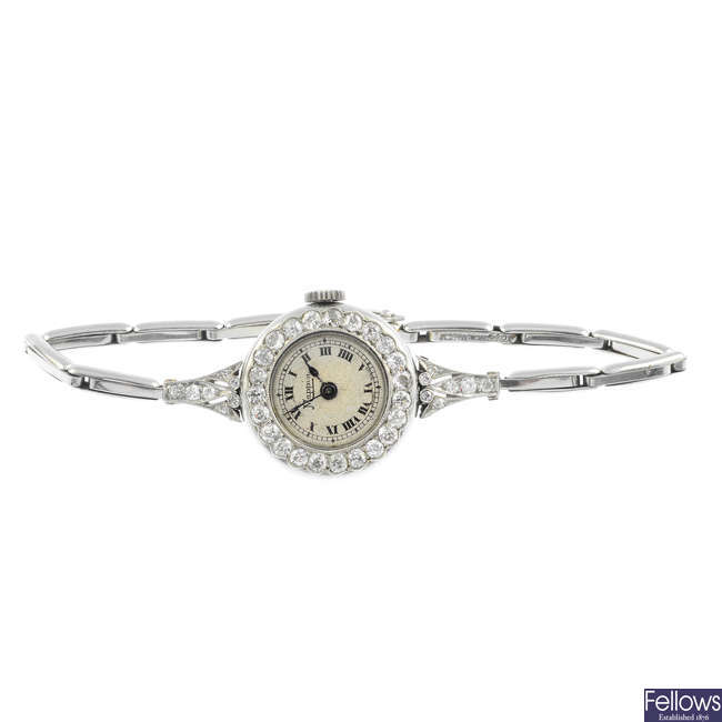 MAPPIN - a lady's mid 20th century platinum diamond cocktail watch.