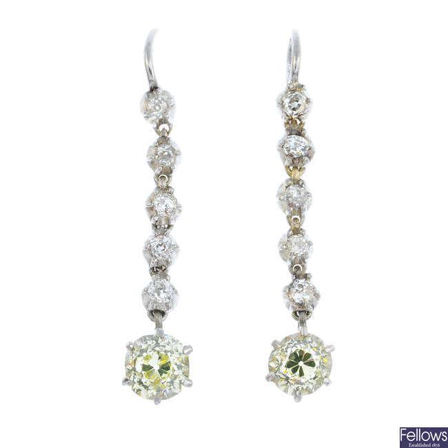 A pair of diamond dropper earrings.