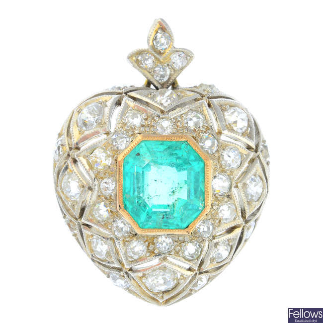 A 14ct gold and silver Colombian emerald and diamond heart pendant.