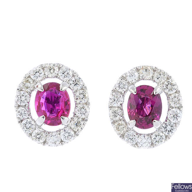 A pair of ruby and diamond cluster earrings.