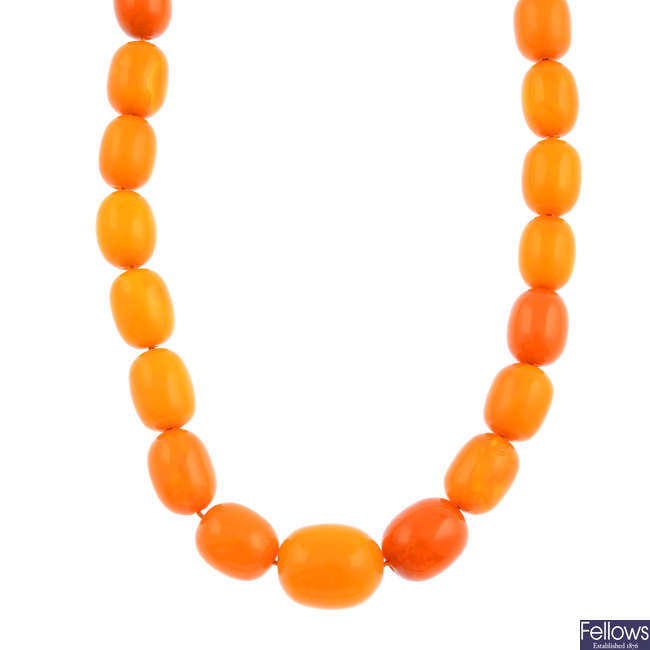 An amber necklace, with matching earrings, attributed to the mother of Raymond Mays.