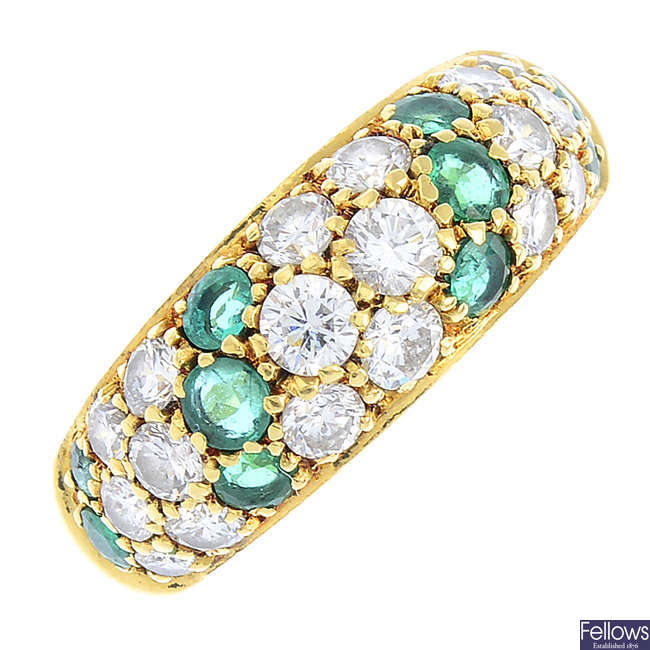 An 18ct gold diamond and emerald ring.