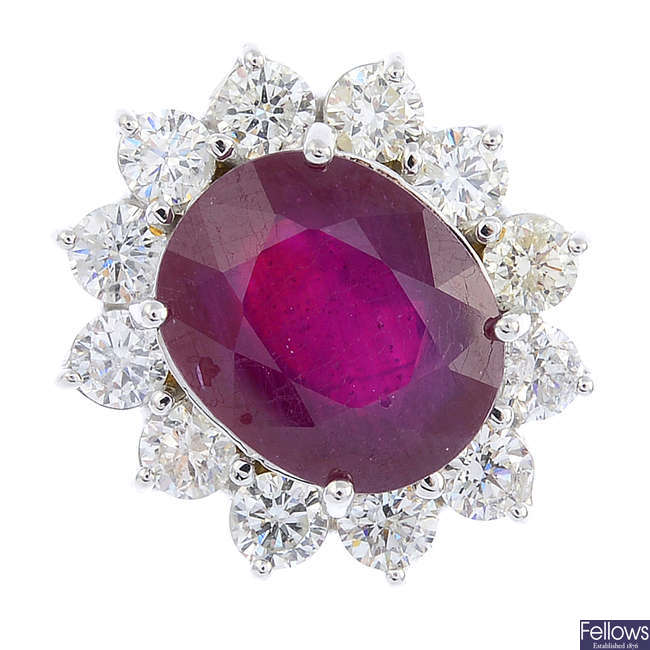 A glass-filled ruby and diamond cluster ring.