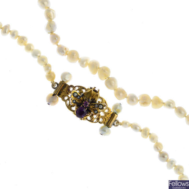 A pearl single-strand necklace, with gem-set butterfly clasp.
