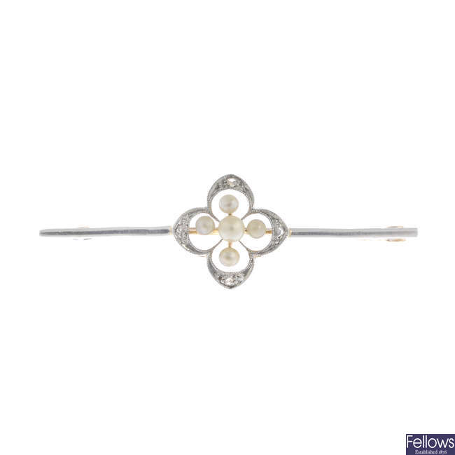 An early 20th century 15ct gold and platinum pearl and diamond bar brooch.
