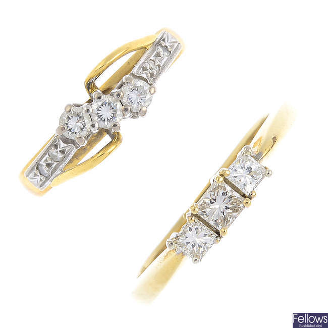 Two gold diamond three-stone rings.