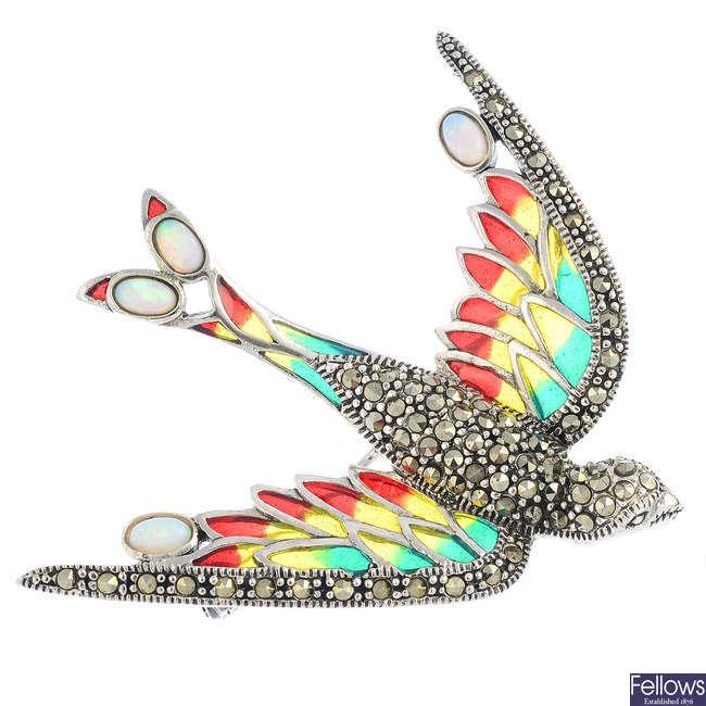 A gem-set bird brooch.