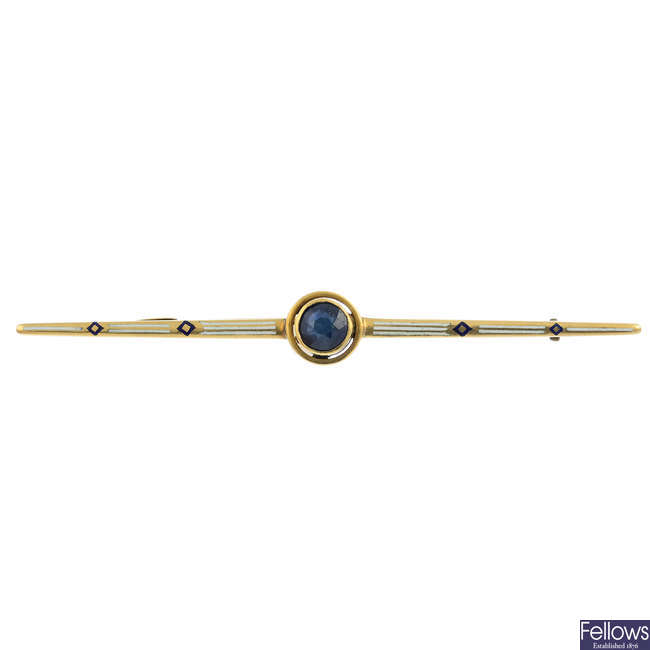 An early 20th century gold sapphire and enamel bar brooch.