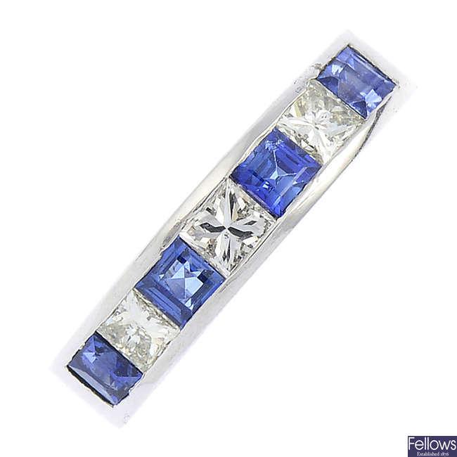 A platinum, sapphire and diamond half eternity ring.