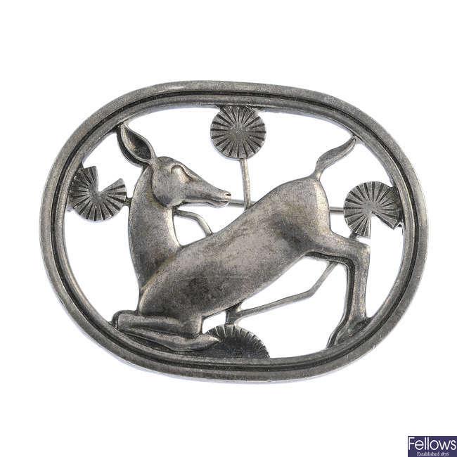 GEORG JENSEN - a silver deer brooch, no. 256.