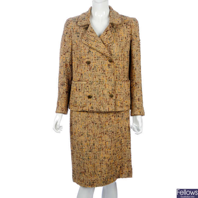 CHANEL - a beige and multicoloured boucle wool skirt suit.