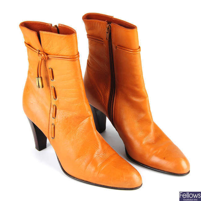 BALENCIAGA - a pair of tan leather ankle boots.