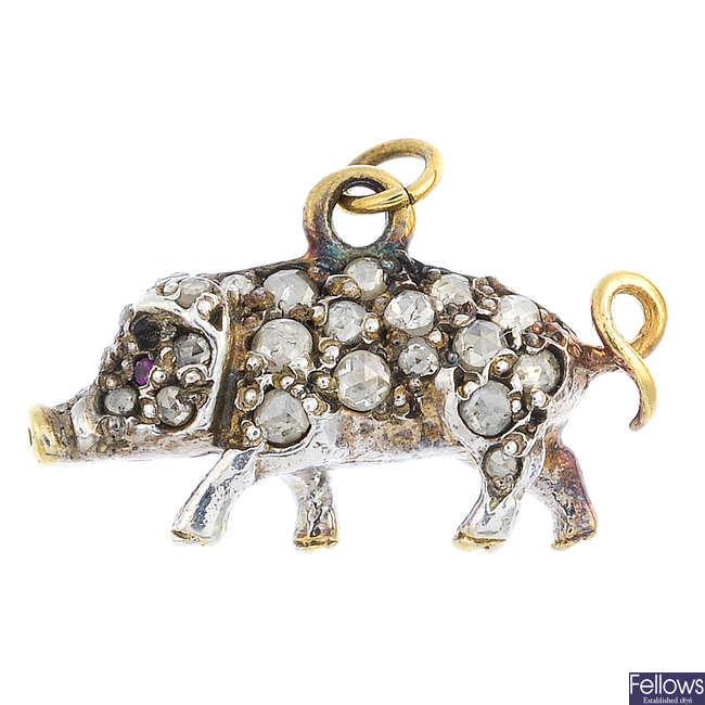 A diamond pig pendant.