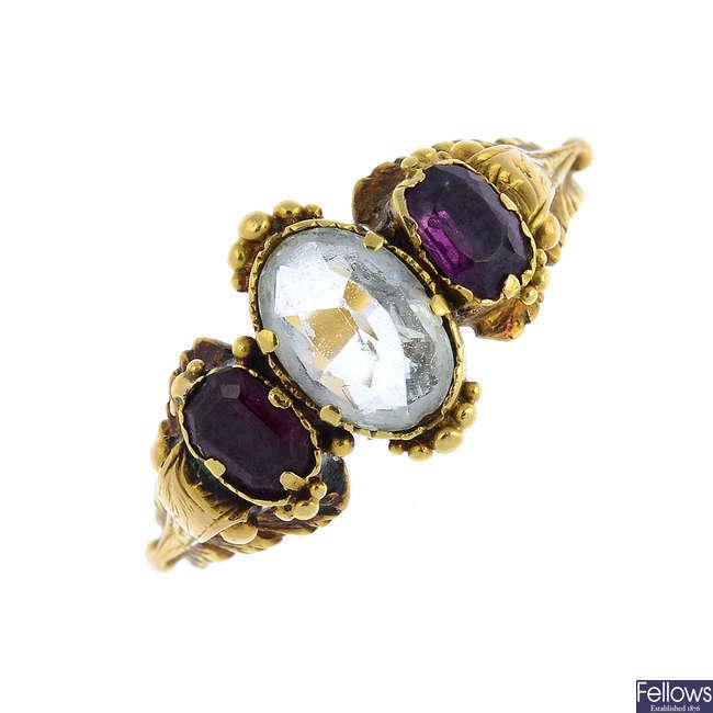 A mid Victorian gold aquamarine, garnet and amethyst three-stone ring.