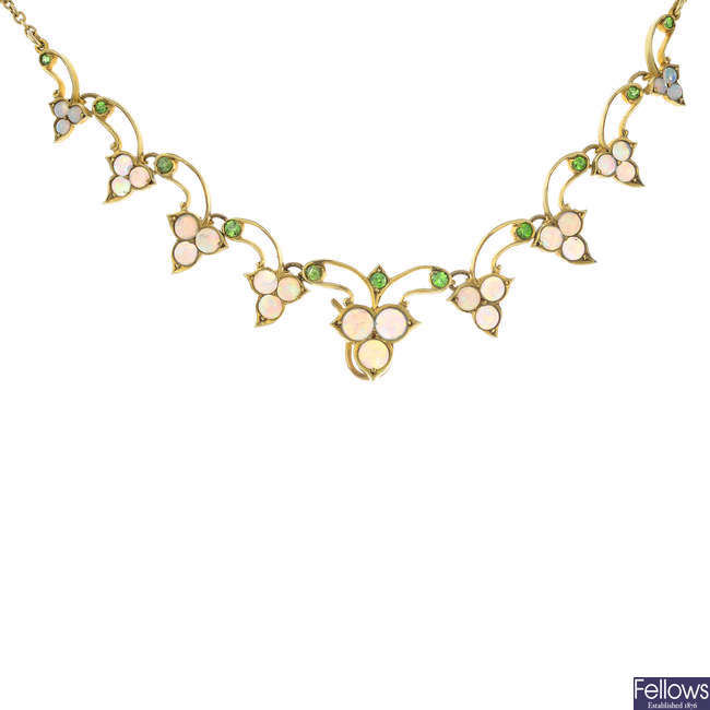 An early 20th century 15ct gold opal and demantoid garnet necklace.