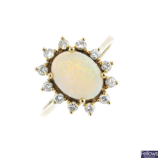 A 9ct gold opal and diamond cluster ring.
