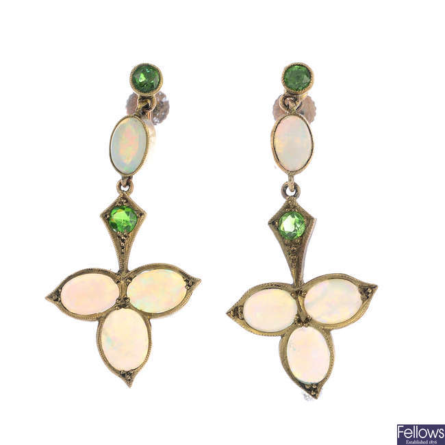 A pair of early 20th century 9ct gold opal and demantoid garnet foliate earrings.
