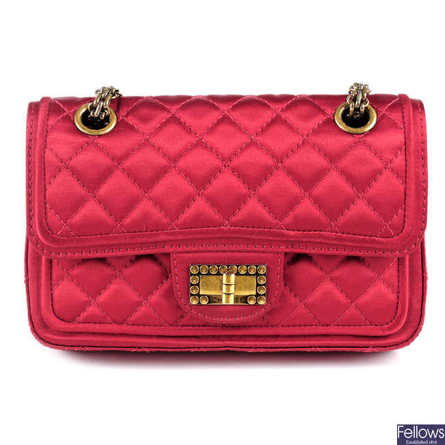 CHANEL - a small quilted red satin double flap handbag.