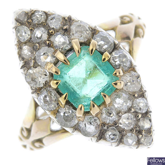 A late Victorian gold emerald and diamond cluster ring.