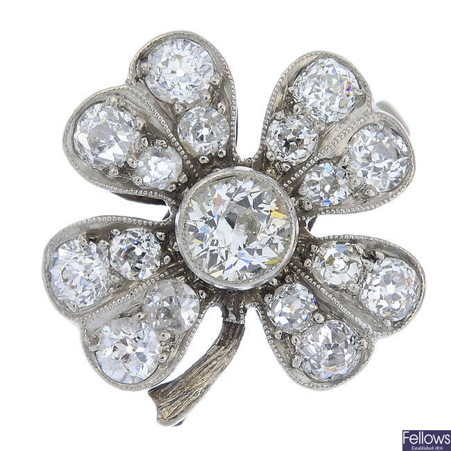 An early 20th century platinum diamond four-leaf clover ring, with later band.