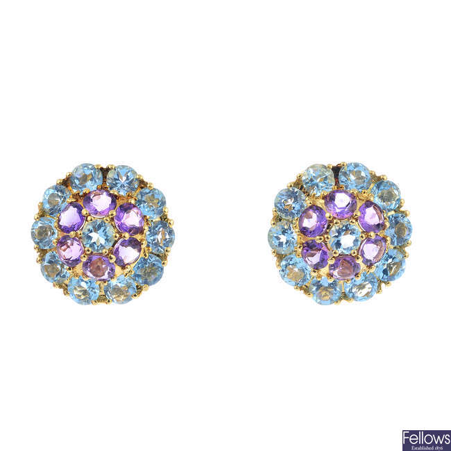 A pair of 18ct gold amethyst and topaz earrings.