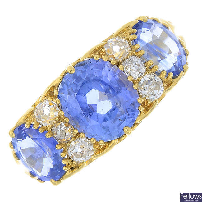 A sapphire three-stone and diamond ring.