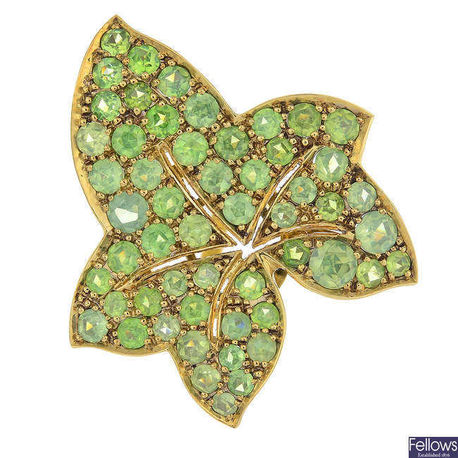 A demantoid garnet leaf ring.