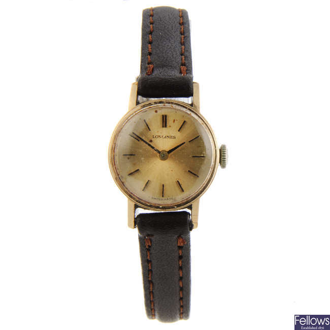 LONGINES - a lady's 9ct yellow gold wrist watch.
