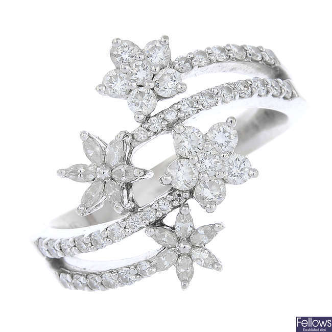A diamond floral crossover ring.