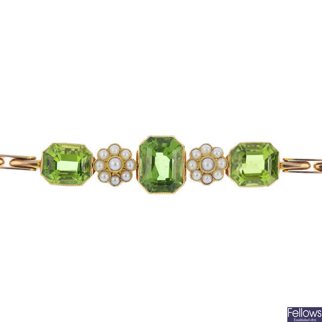 An early 20th century gold, peridot and split pearl bracelet.