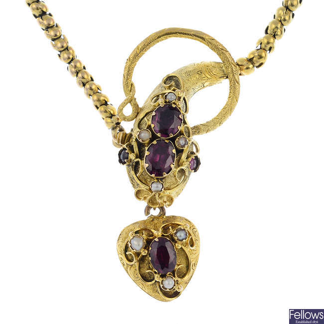 A late Victorian 18ct gold garnet and split pearl snake necklace.