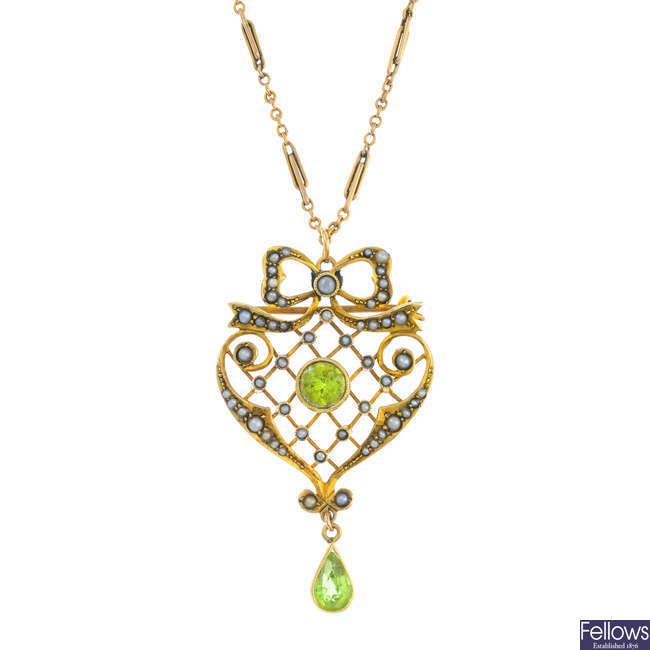 An early 20th century 9ct gold peridot and split pearl pendant, with 9ct gold chain.