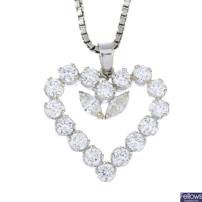 A diamond heart pendant, with chain.