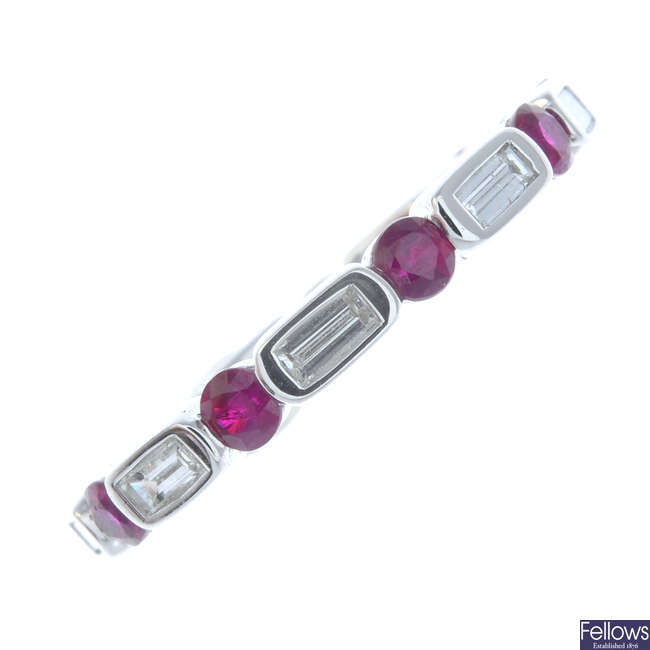 An 18ct white gold ruby and diamond full eternity ring.