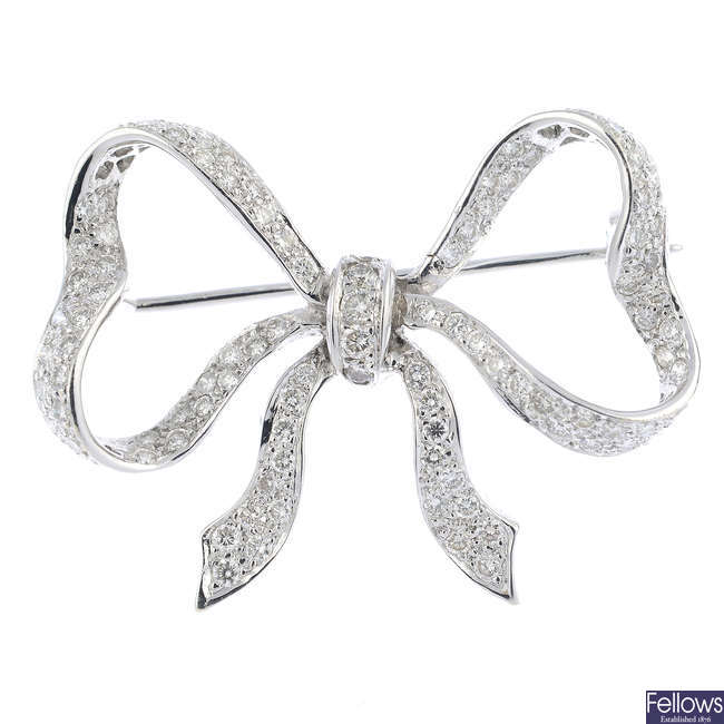 An 18ct gold diamond bow brooch.
