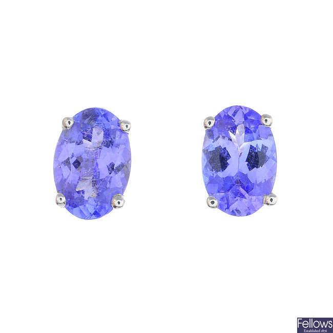 A pair of oval-shape tanzanite single-stone stud earrings.