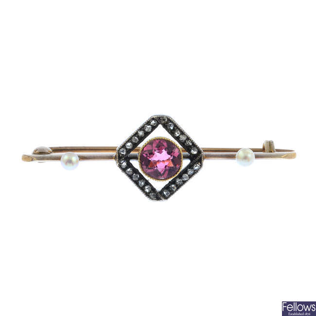 An Edwardian gold and silver, pink tourmaline, diamond and seed pearl bar brooch.