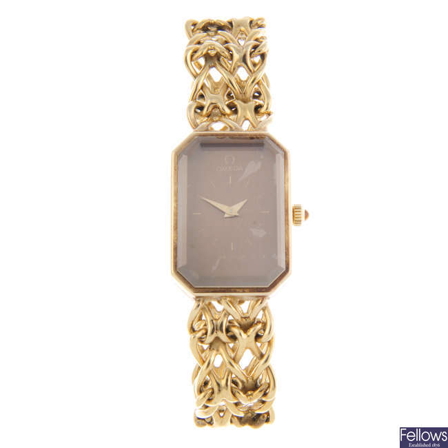 OMEGA - a lady's gold plated silver De Ville bracelet watch.