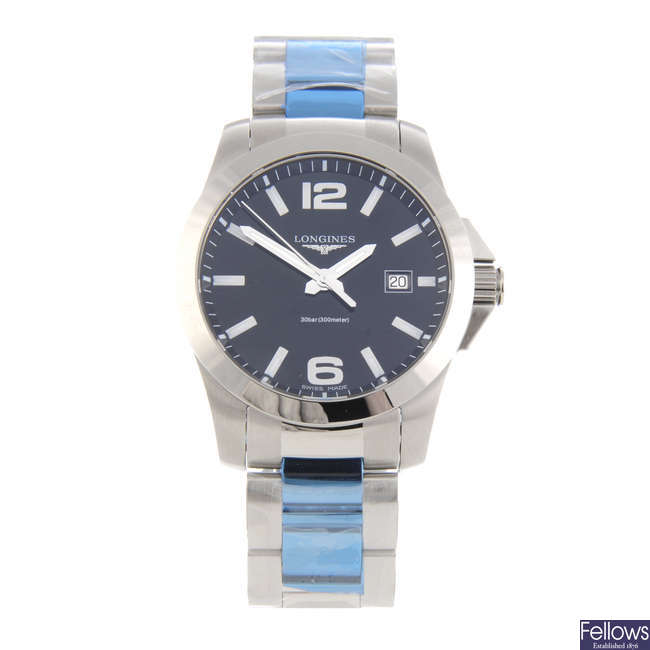 LONGINES - a gentleman's stainless steel Conquest bracelet watch.