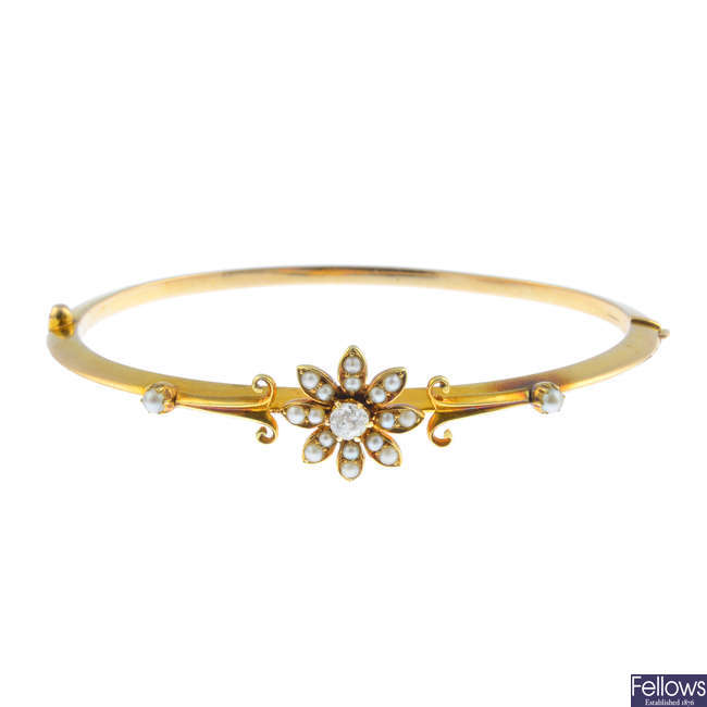 An early 20th century 15ct gold, split pearl and diamond hinged bangle.